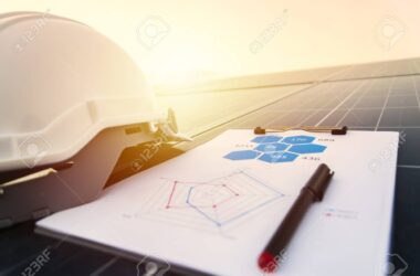 working solar station photovoltaic panels,Science solar energy,engineer working on checking and maintenance equipment at industry solar power,Chart Section Power consumption.