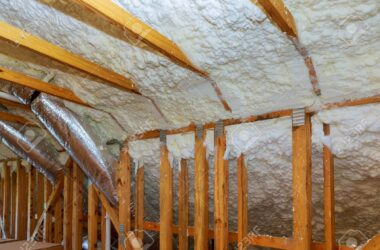 New home construction with installation of termal insulation installing at the attic the roof